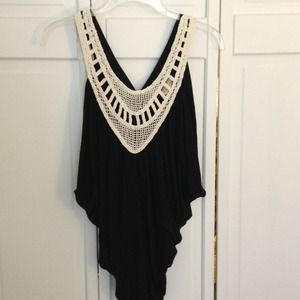 Black tank with crochet embroidery.