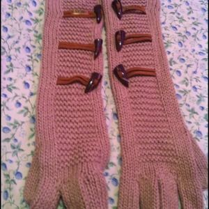 Two pairs of ugg$ gloves