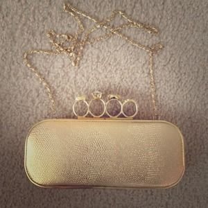 Edgy Gold Ring Clutch