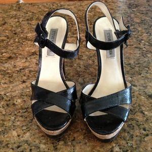 Black patent leather Steve Madden platform heels.