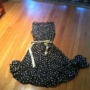Sheer polka dot sleeveless dress.