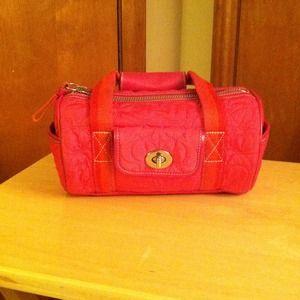 Pink Coach barrel bag