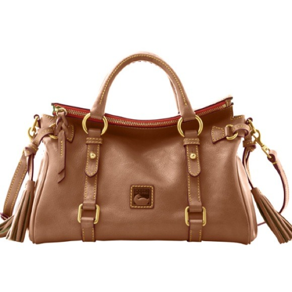 Like a shiny new toy, this patent leather satchel will catch the eye of every passerby. From Dooney & Bourke.
