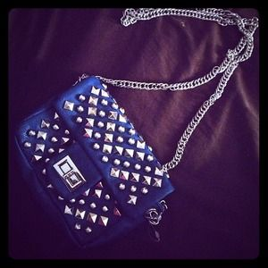 Clutches & Wallets - Small blue purse covered in flashy spikes/studs.