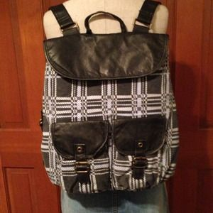 Handbags - It's a backpack of course. Faux leather detail.