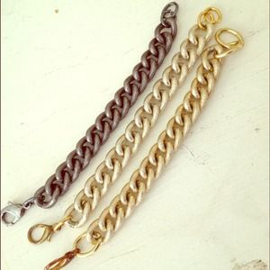 Set of three chain link bracelets.