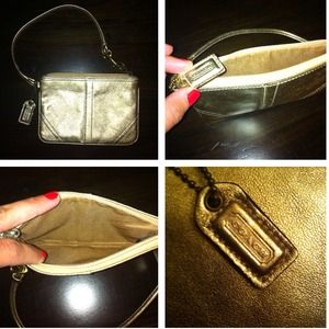 Metallic gold Coach wristlet