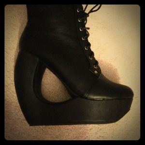 Brand new black booties with detail cut out