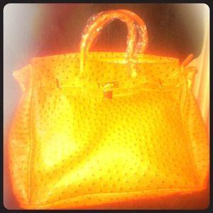 Beautiful designer inspired ostrich bag in orange.