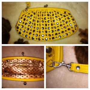 Studded clutch with attachable wristlet