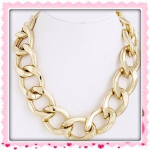 Gold curb chain necklace..