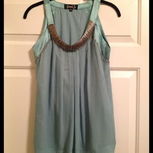 Hannah Jo light blue top with metal accents. Sz S