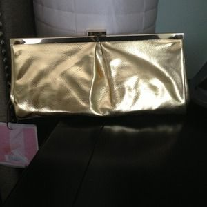 Gold evening clutch by Michael Kors