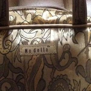 Modella little purse sold
