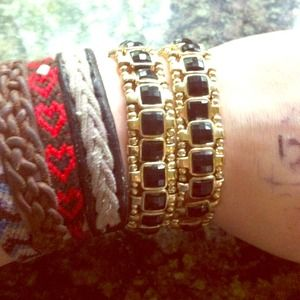 Jewelry - Black and gold braclets