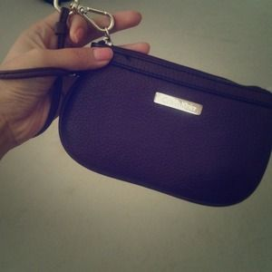 Calvin Klein plum-colored wristlet (like new)