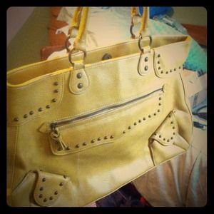 Mustard yellow bag with studs