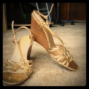 Gold wedged heels