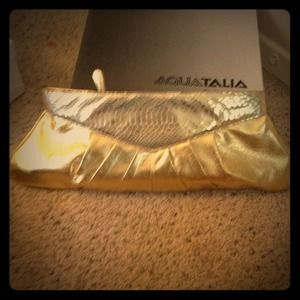 Oversized gold leather clutch. Perfect for parties