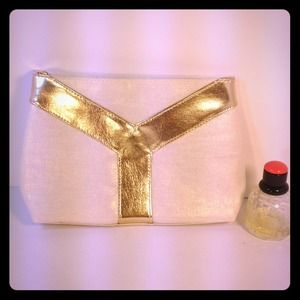 ReservedYves Saint Laurent clutch or travel bag.