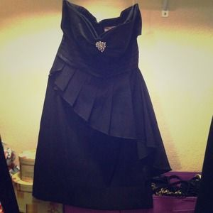 Black cocktail dress by Romeo and Juliet Couture