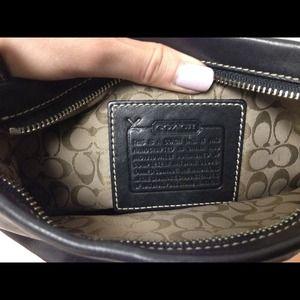 100% authentic black leather Coach pouch / handbag