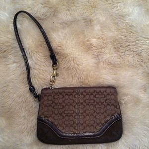 **MUST GO!!** Classic Brown coach wristlet!
