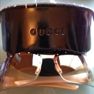 Authentic Gucci Sunglasses with bronze studs