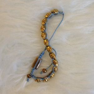 Urban Outfitters Jewelry - Light Blue & Gold Skull Bracelet