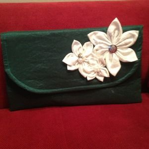 Hunter green envelope clutch.