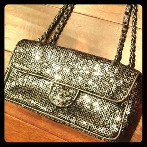 CHANEL Handbags - SOLD!! Authentic CHANEL silver sequin classic bag