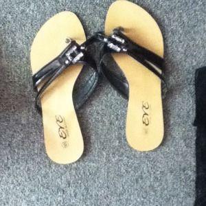 eve Shoes - Brown and black flip flops.