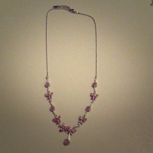 Silver necklace with pink flowers and butterflies