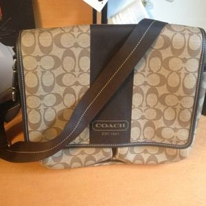 Coach Handbags - RESERVED! Never worn authentic coach messenger bag