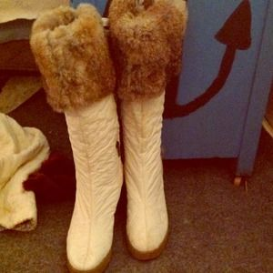 Barely worn winter boots. Knee high with lace/fur.