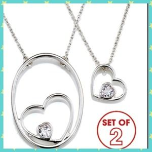 avon Jewelry - 💚Nesting hearts duel charm necklace💜