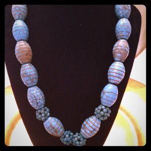 100% barrel style turquoise necklace.