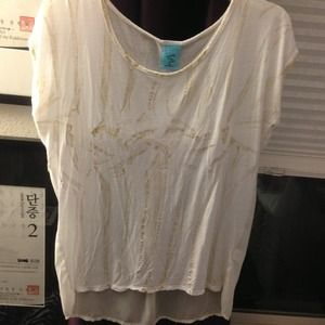 White short sleeve, sheer back top.