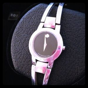 Women's stainless steel Movado watch.