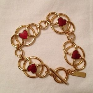 Jewelmint gold bracelet with red hearts.