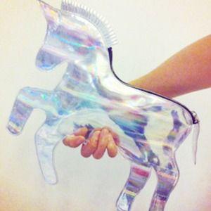 SOLD Laser hologram unicorn clutch purse.