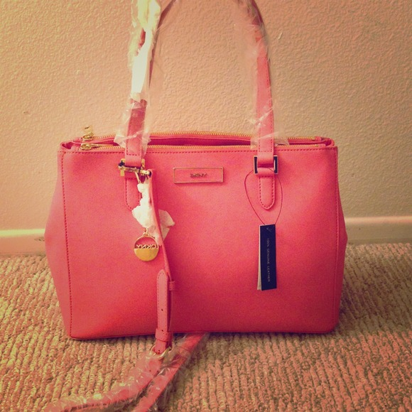 DKNY - ⛔SOLD⛔ DKNY light pink/coral purse from Marina's closet ...