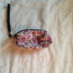 Flower and sequenced double zipper wristlet!