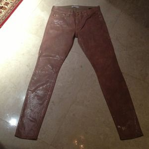 Jeans with snake skin leather look
