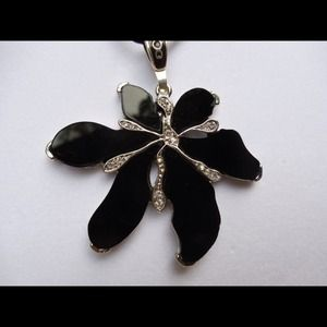 Black flower necklace.