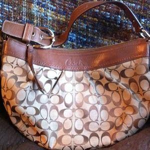 Tan/Light Brown Coach bag The signature collection