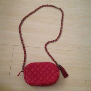 F21 red quilted crossbody bag with tassle