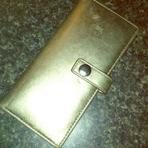Authentic Coach slim gold wallet