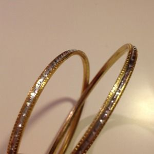 Jewelry - Two dainty gold and silver bangles