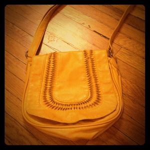Mustard yellow handbag purchased from mod cloth